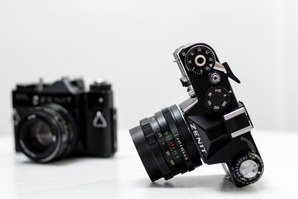 black Zent DSLR camera with white background