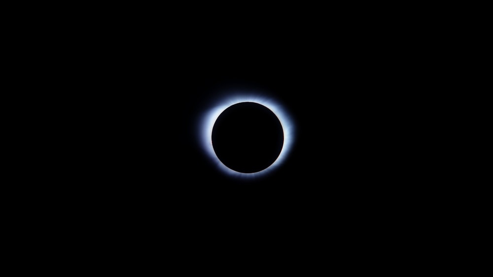 low angle photo of solar eclipse