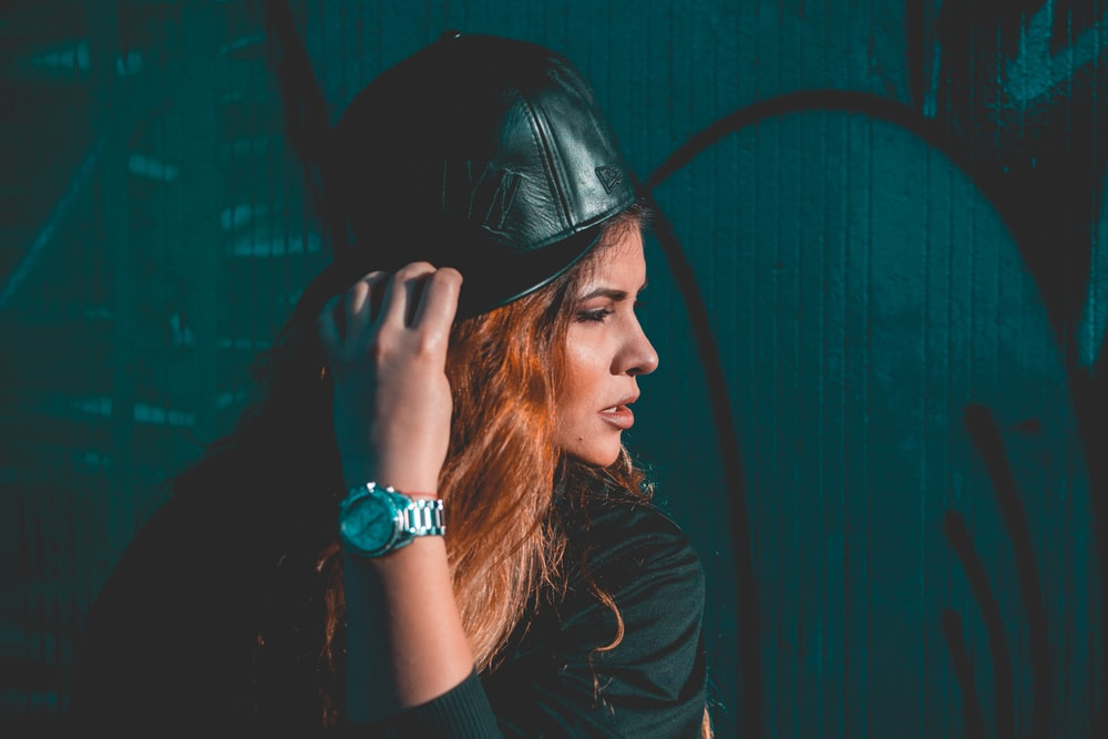 woman wearing black leather fitted cap