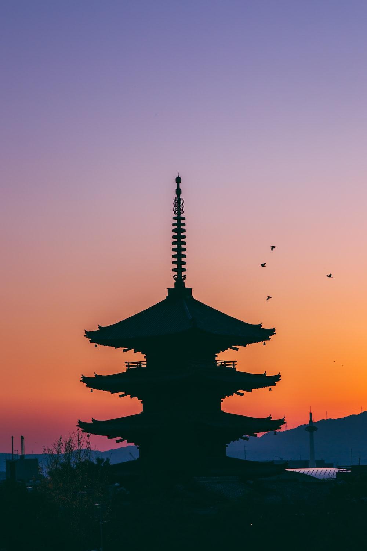 silhouette photo of pagoda