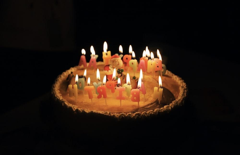 Round Happy Birthday Cake With Lighted Candles Photo Free Birthday Cake Image On Unsplash