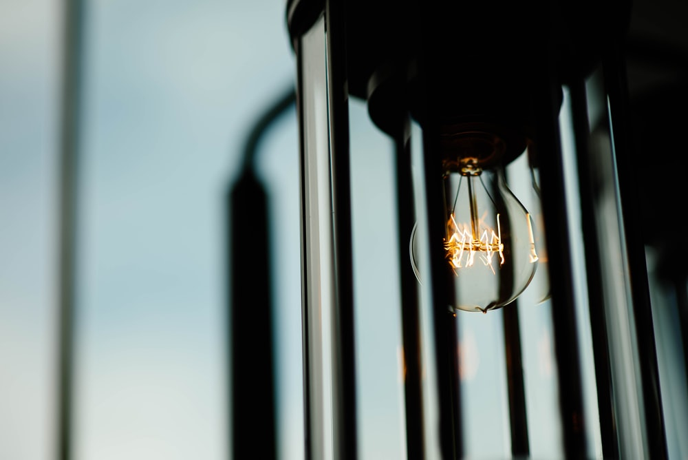 shallow focus photography of light