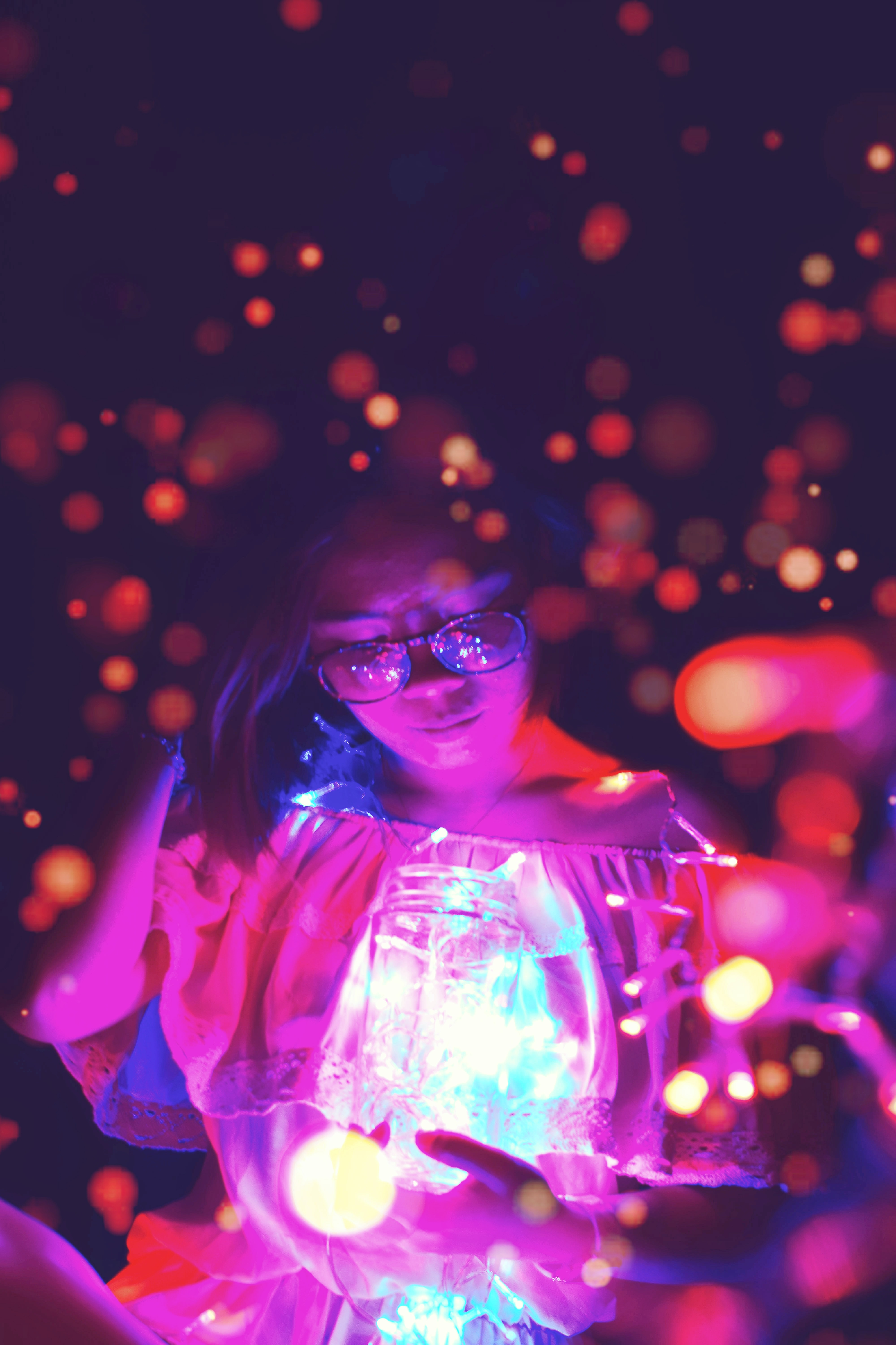 woman holding glass jar with bokeh light background