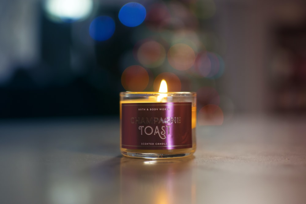 lighted Toast candle on gray panel