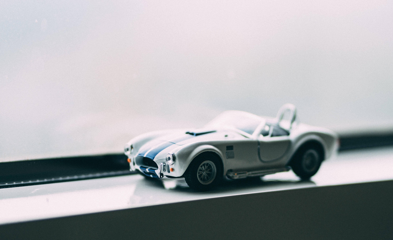 white sports car die-cast model