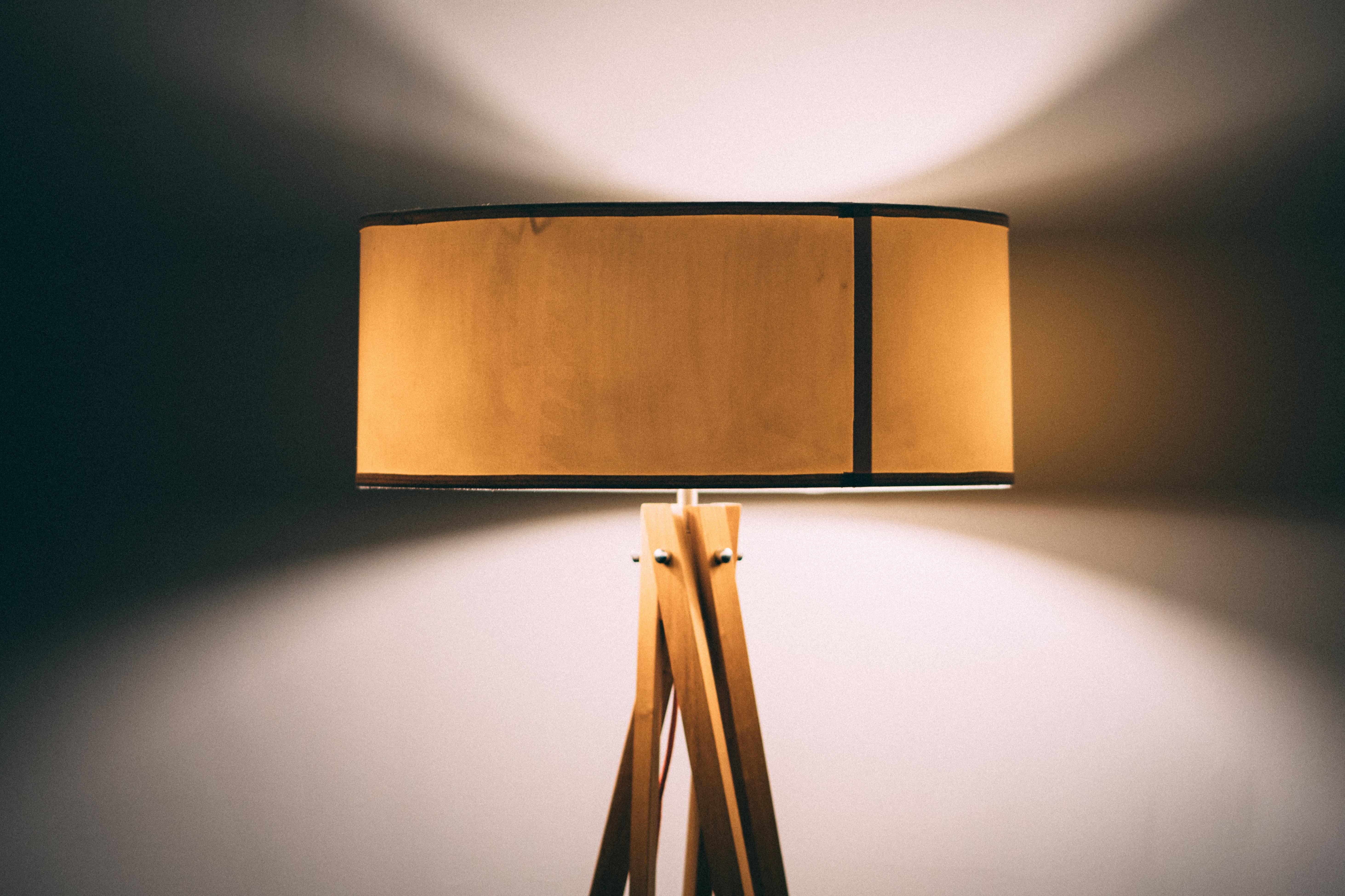 brown wooden tripod lamp
