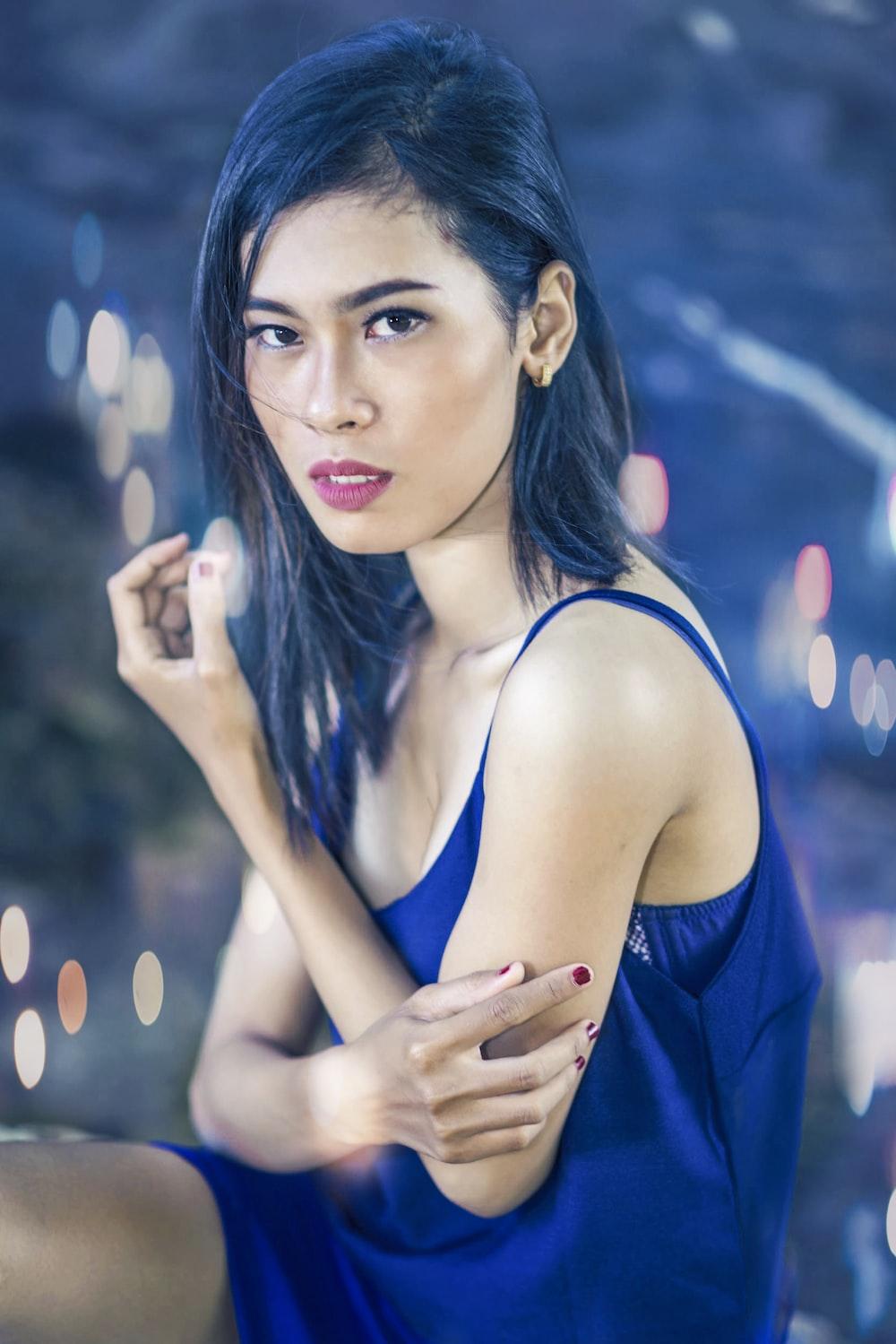 woman in blue spaghetti strap top bokeh photography