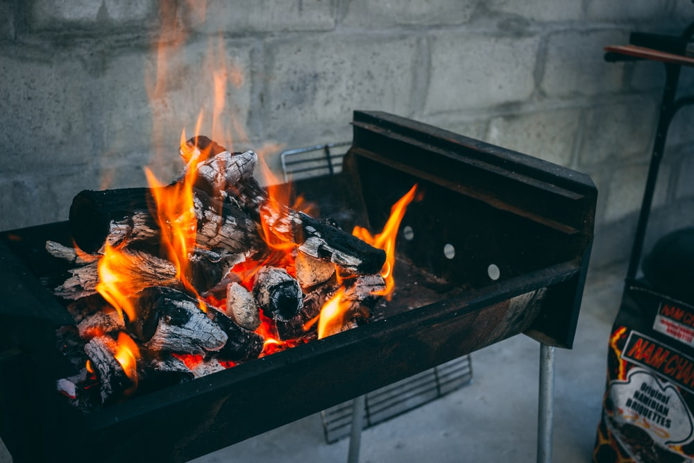 flaming charcoal on black grill