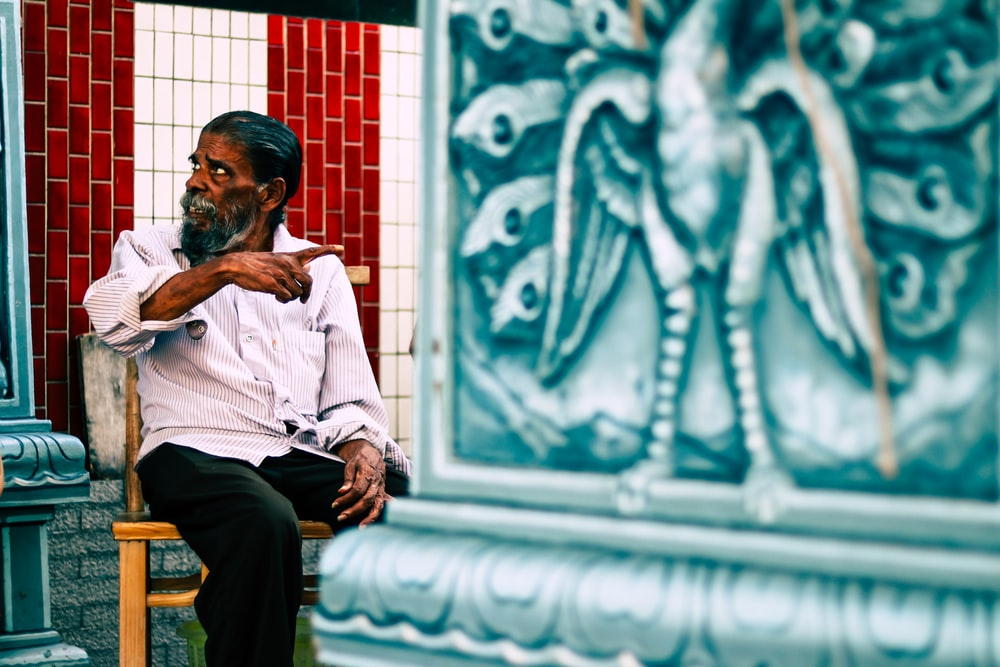 man sitting on chasir