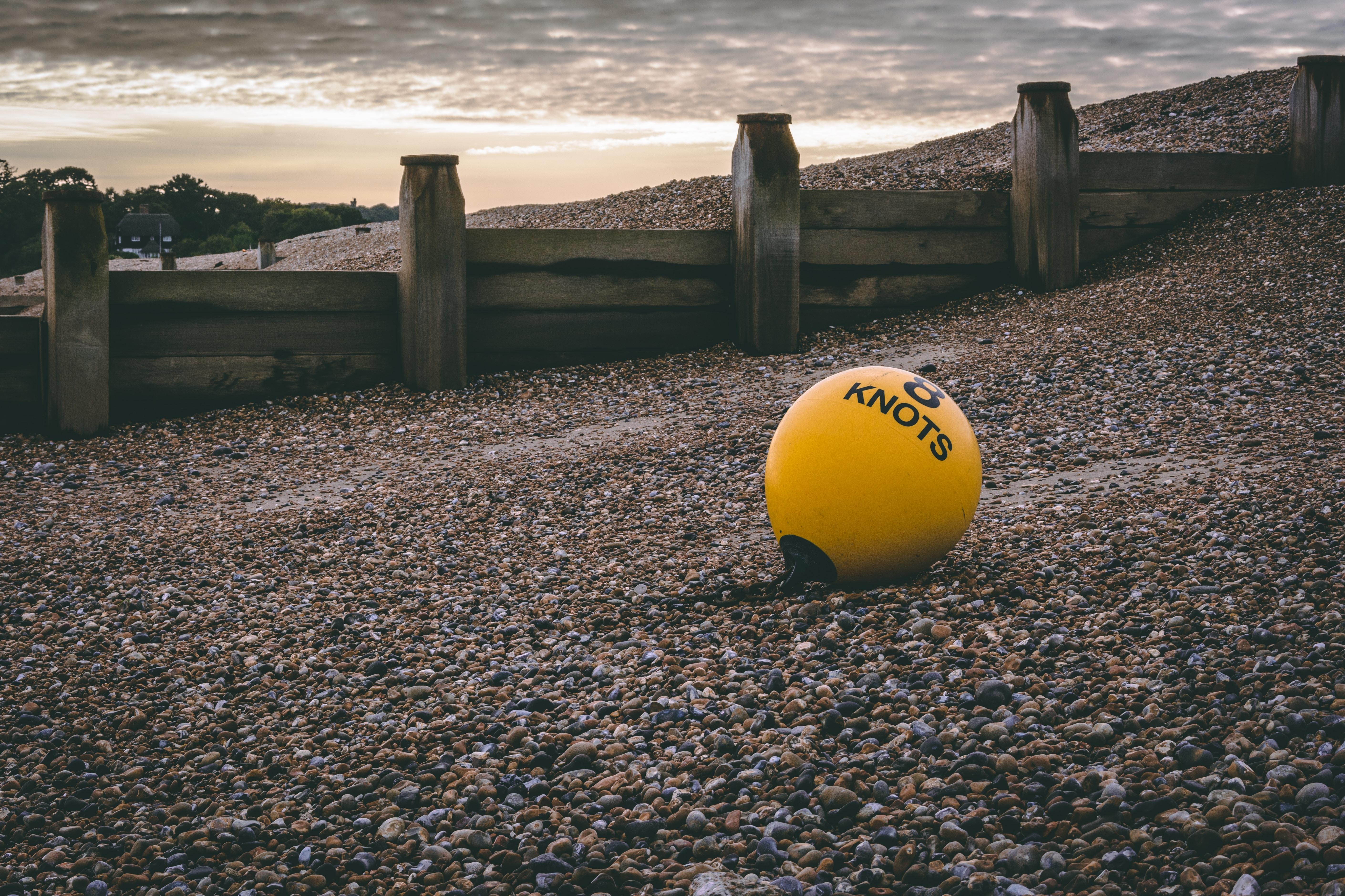 yellow 8 knots ball on pebble