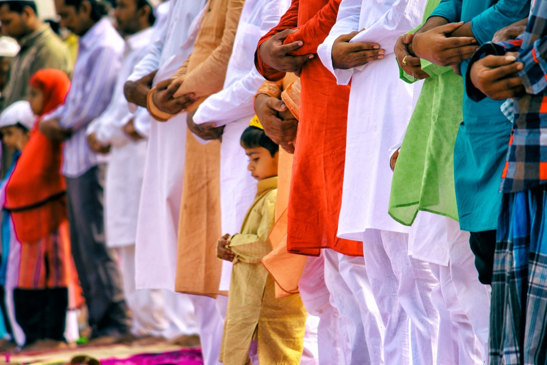 A Child Praying with Tricolor Indian Flag