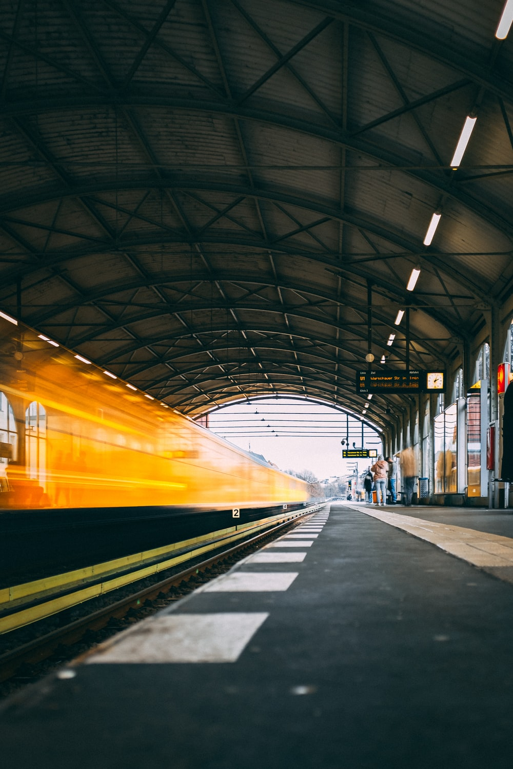 train passing by on train station at daytime