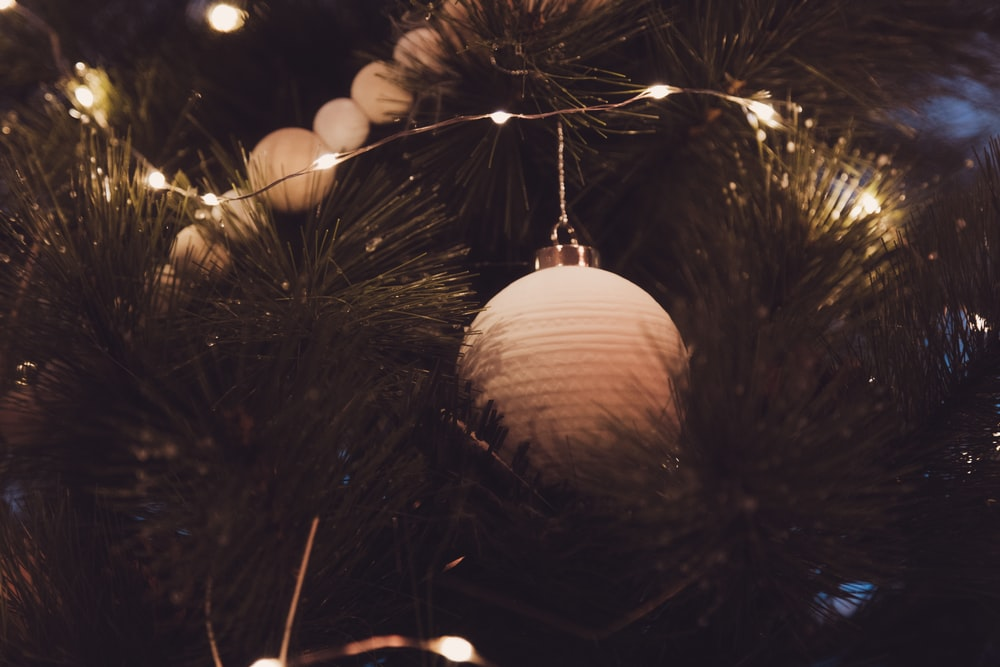 white bauble in Christmas tree