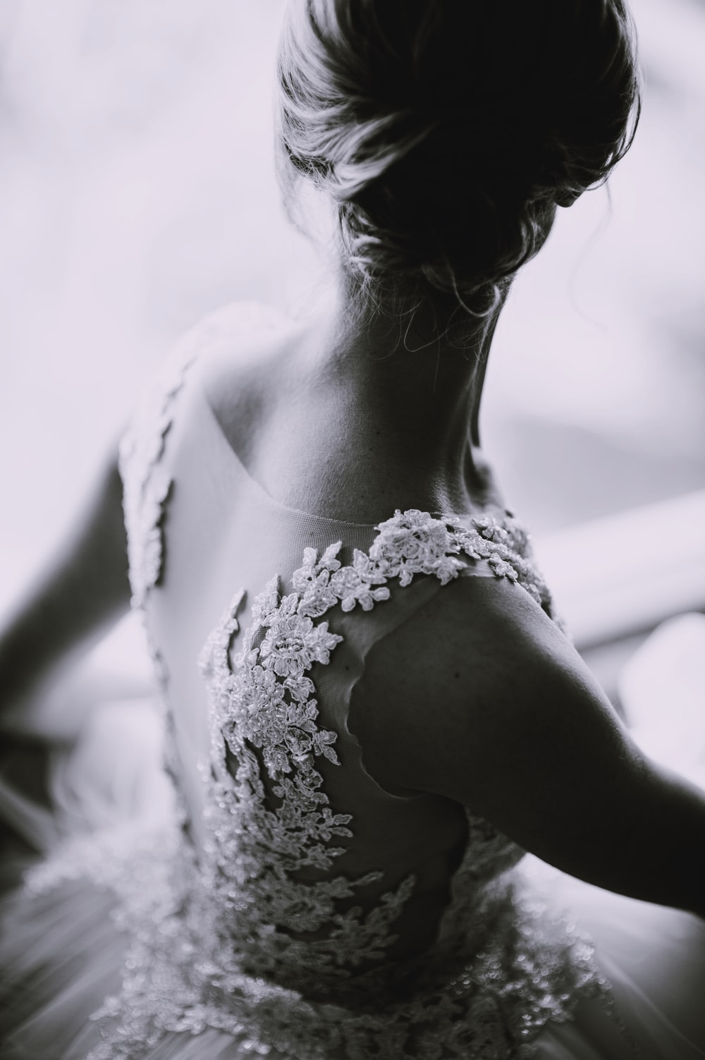 grayscale photography of a woman in lace sleeveless dress