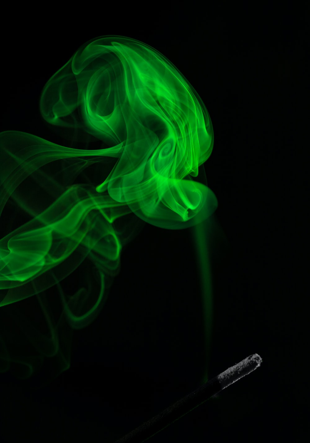 green smoke on dim light