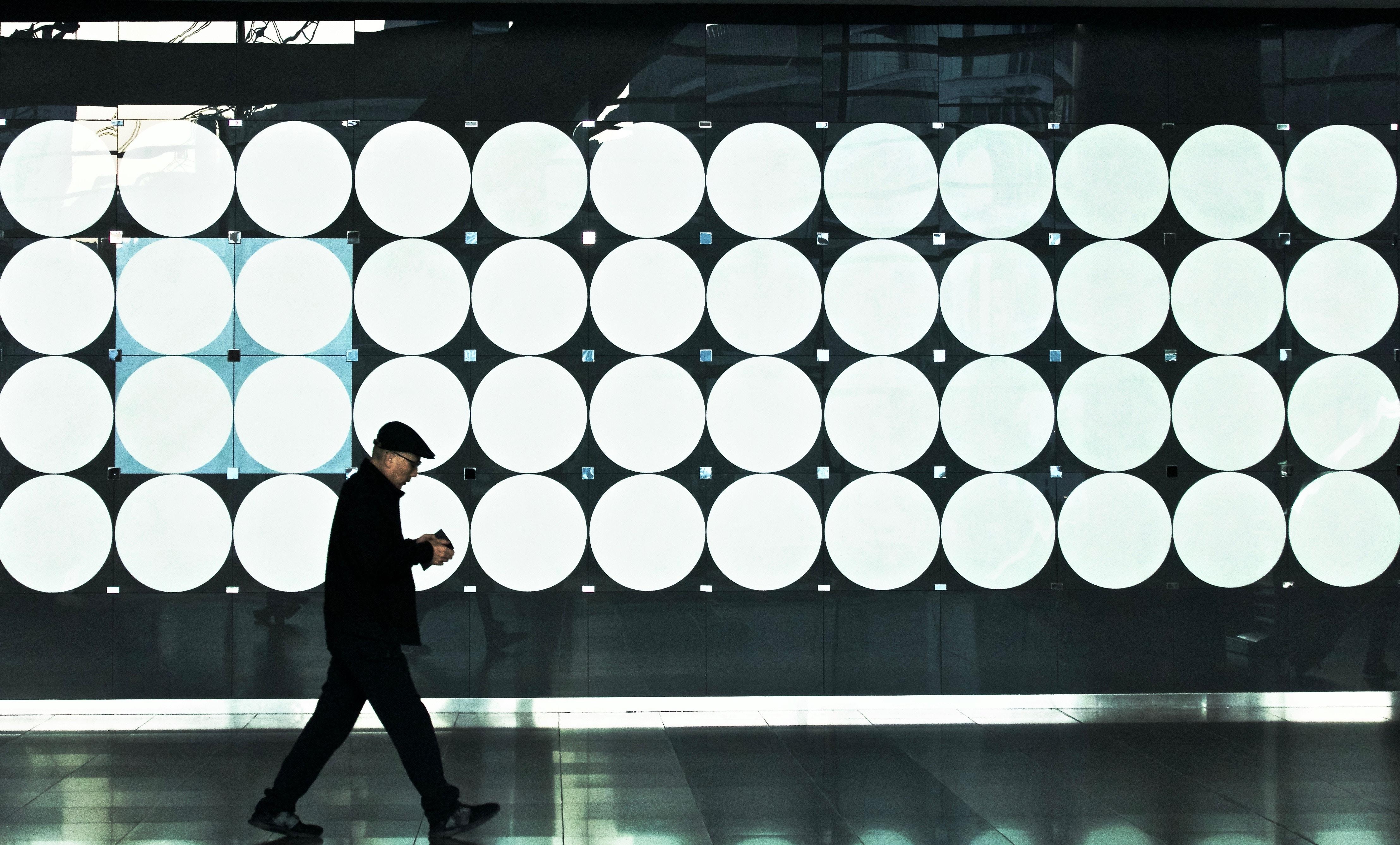 man walking near lights