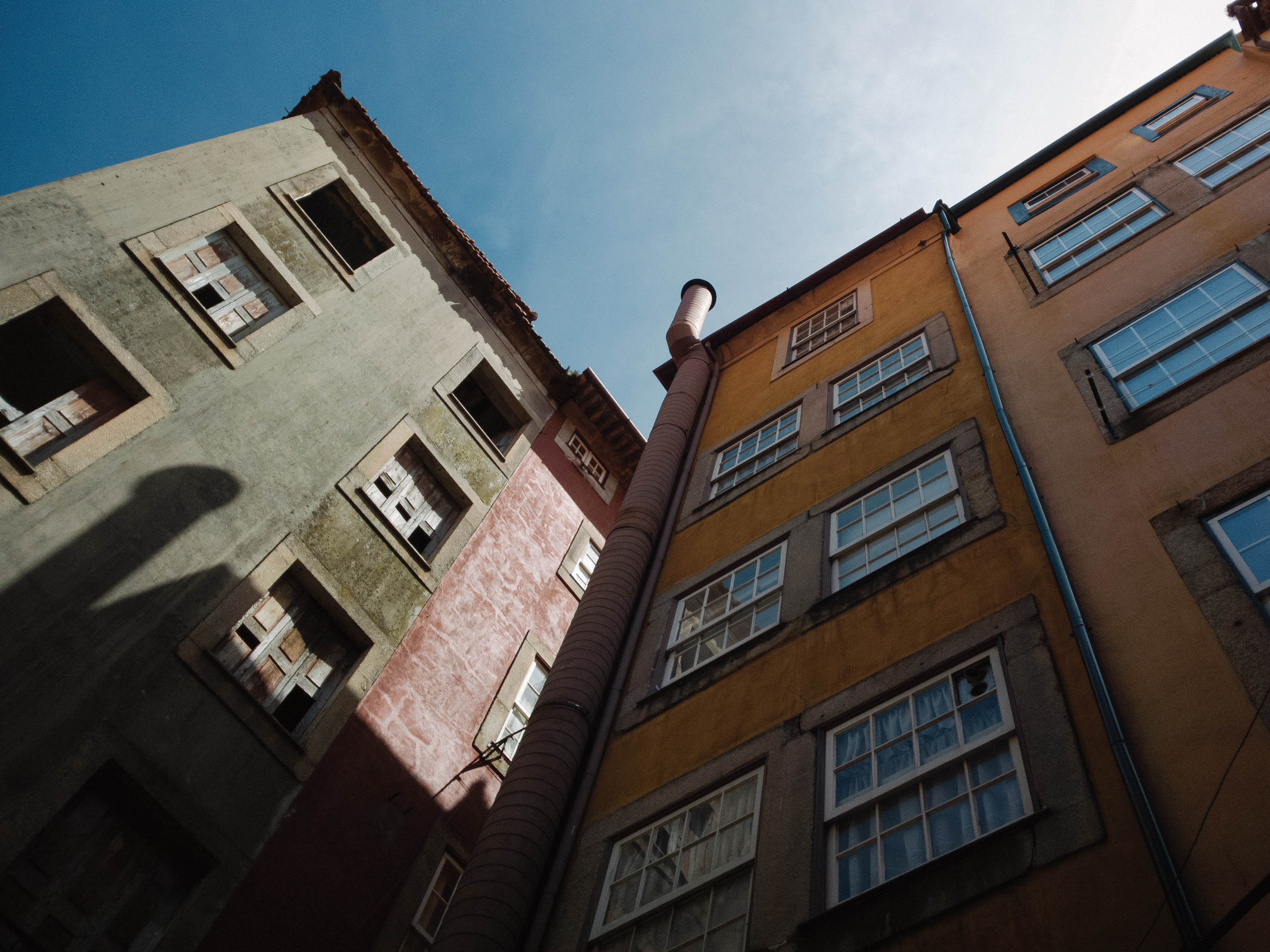 low angle photography of two buildings under clear sky