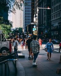 lowlight photography of man riding skateboard on street