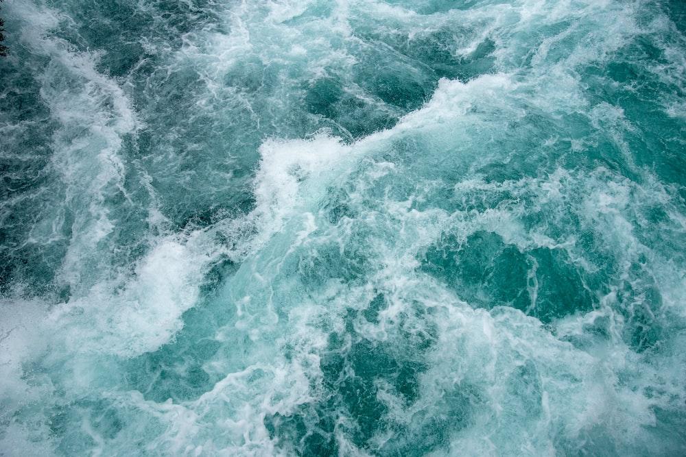 green ocean waves at daytime