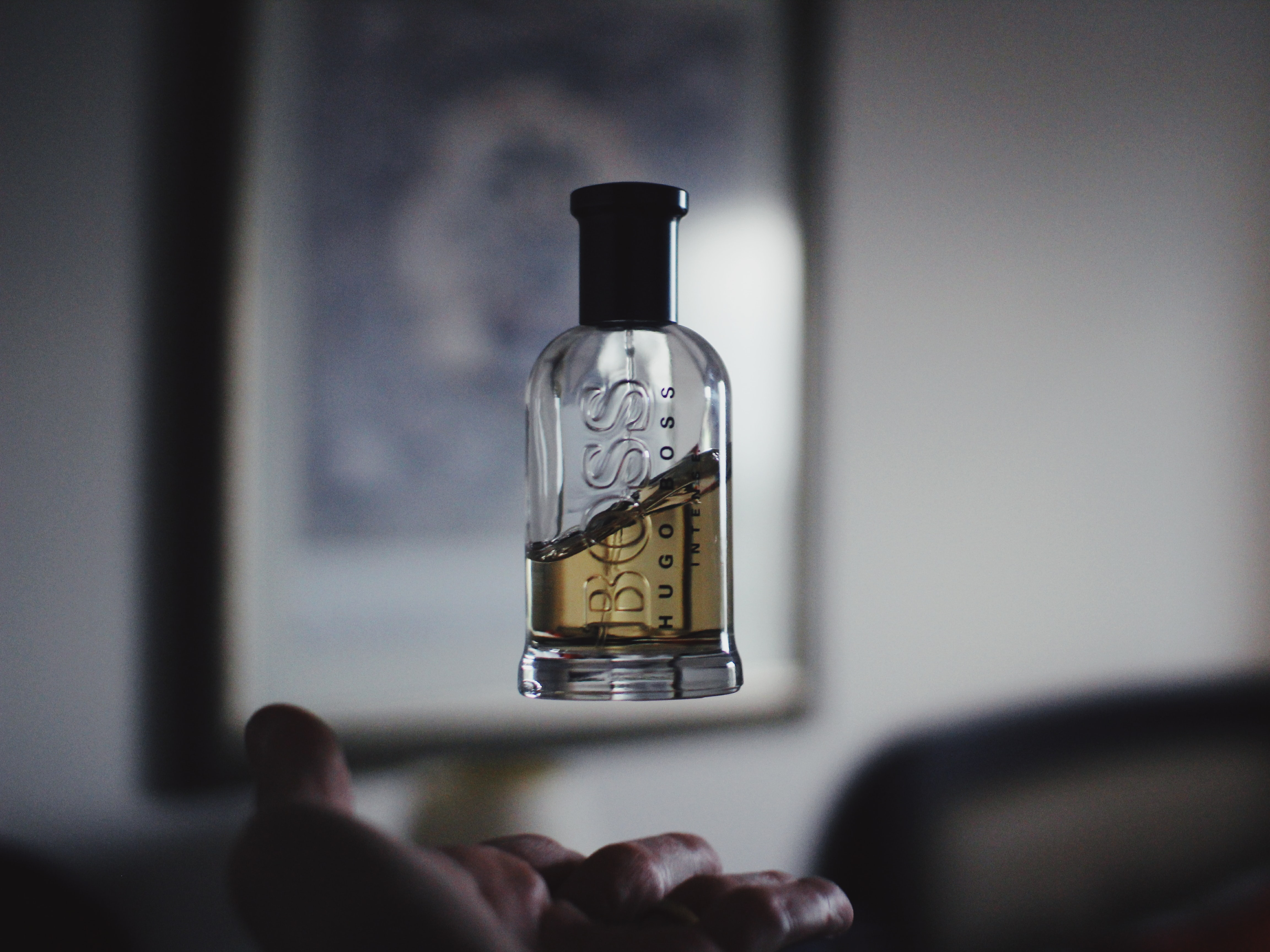 shallow focus photography of floating perfume bottle