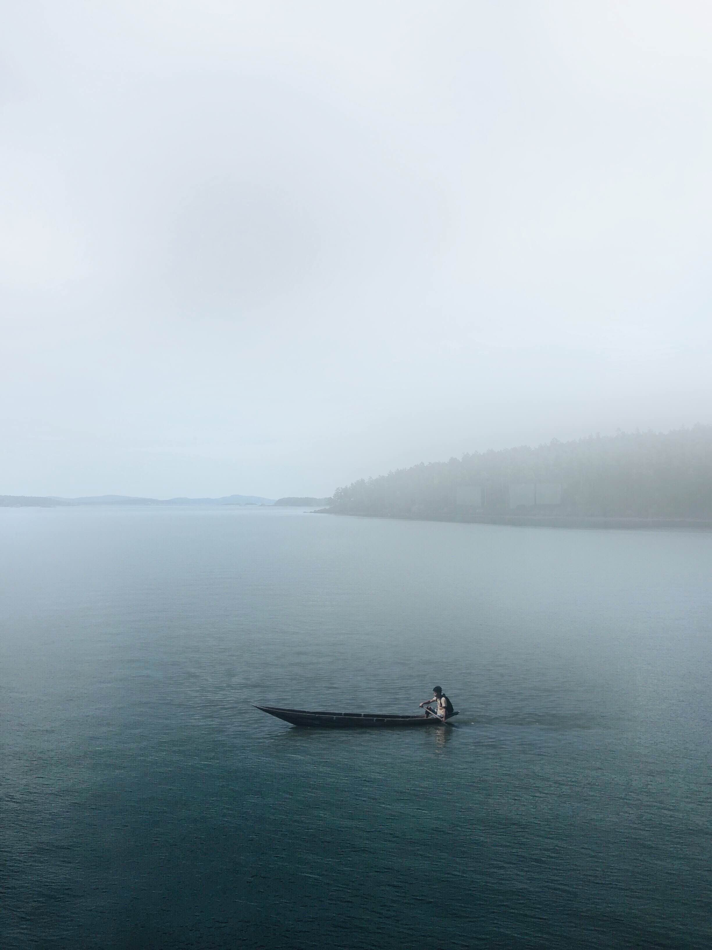 photo of person on canoe