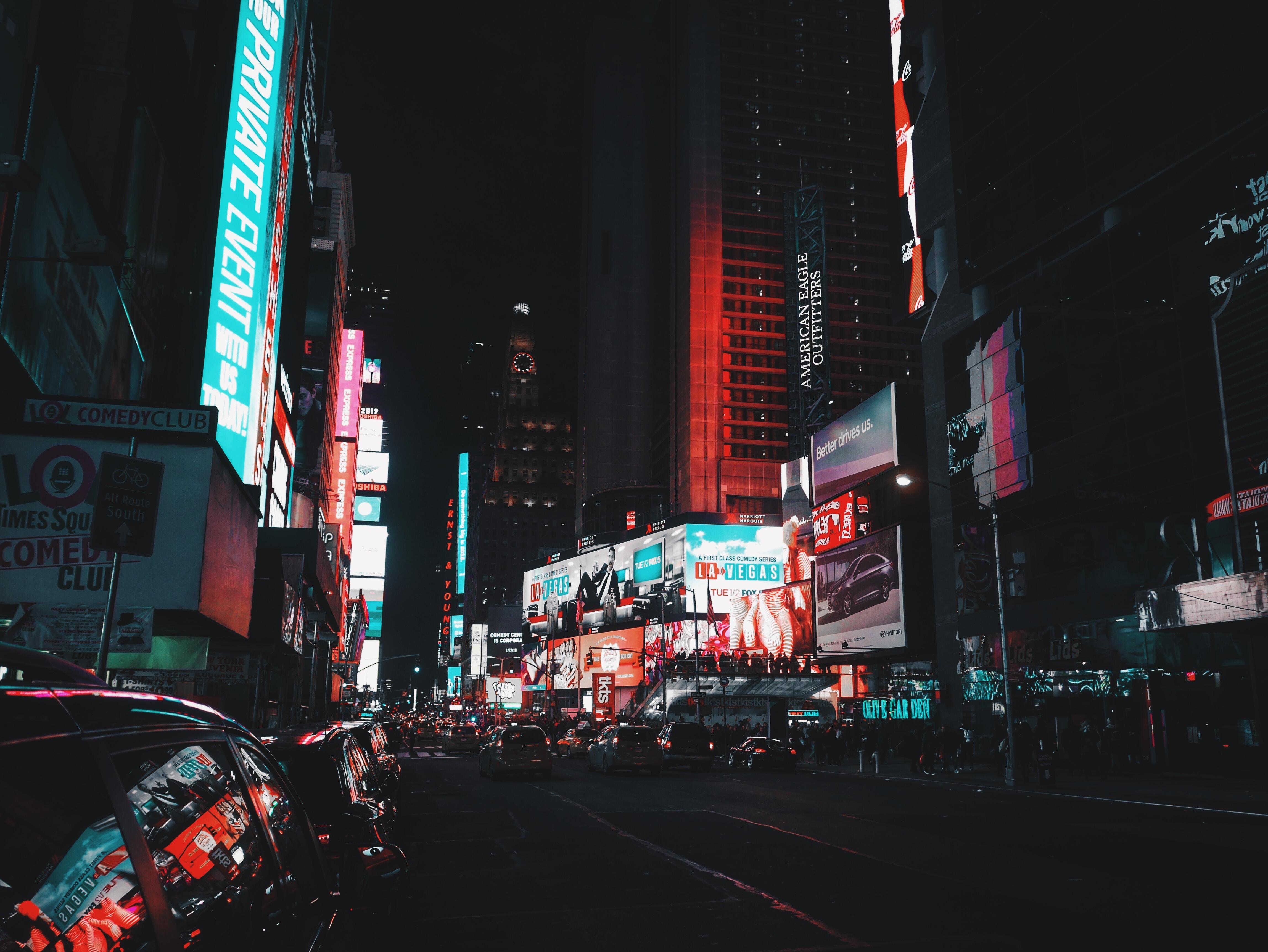 city skyline under black sky during nighttime