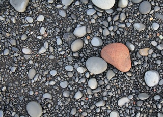 flat lay photography of gray pebbles