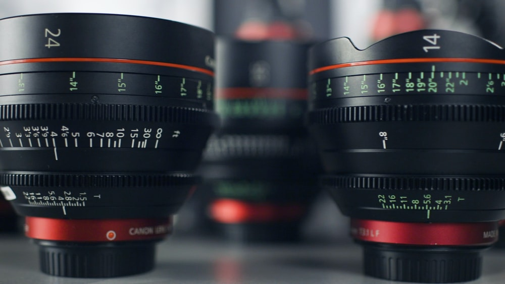 two black-and-red camera lens