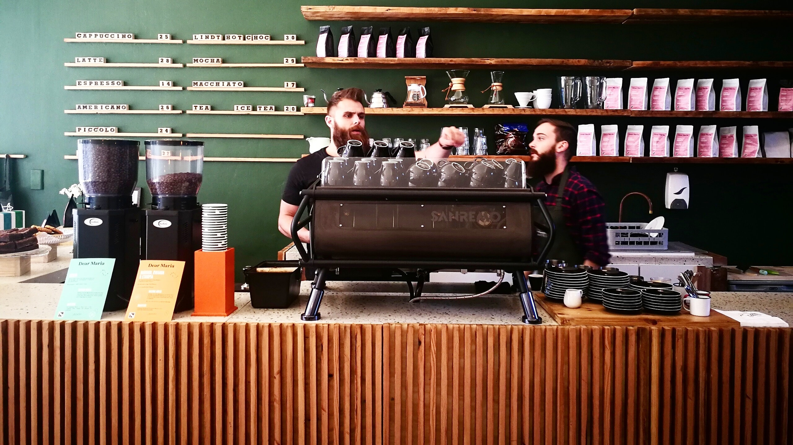 two men standing near counter in coffee shop