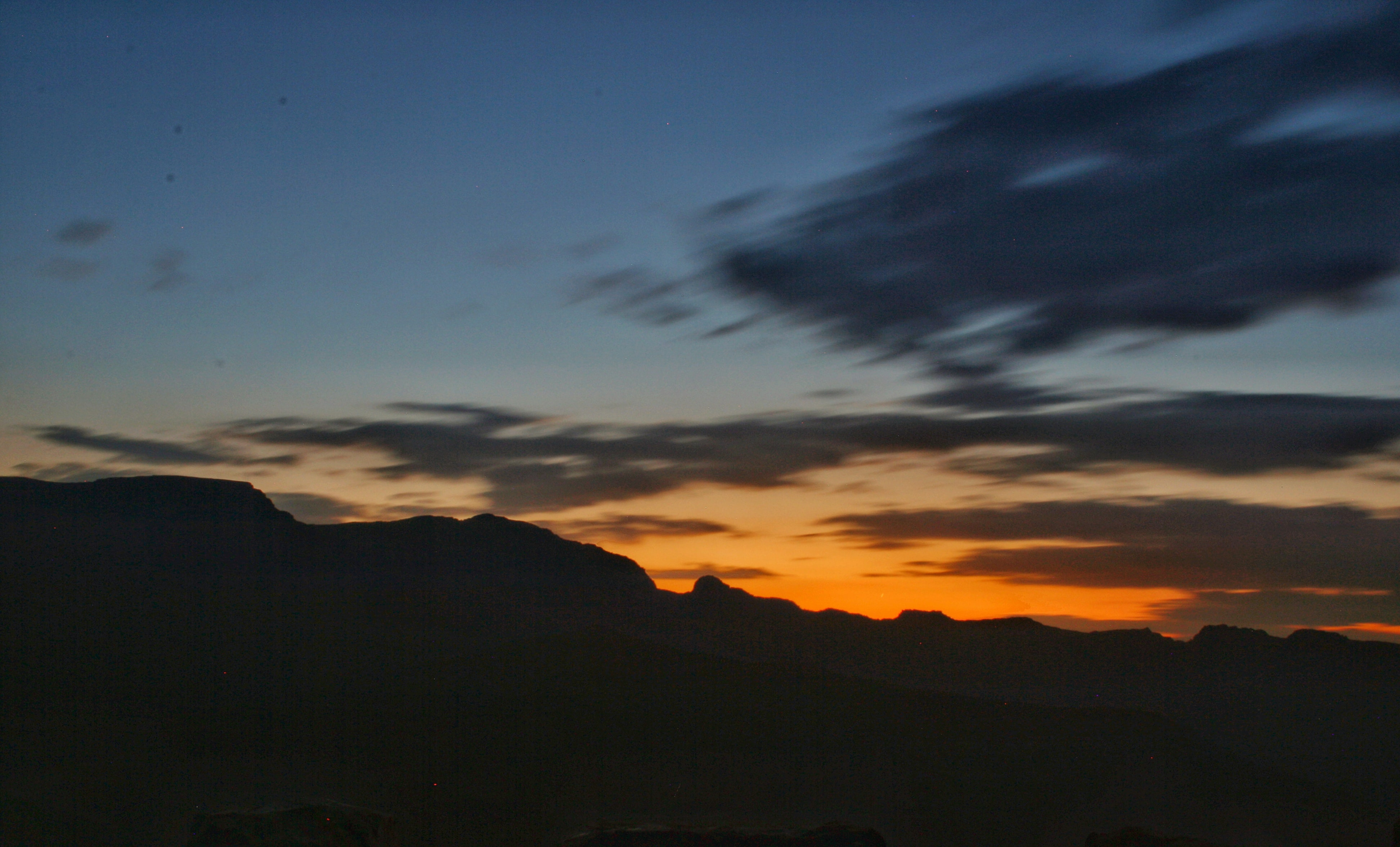 time-lapse photography of silhouette of mountains