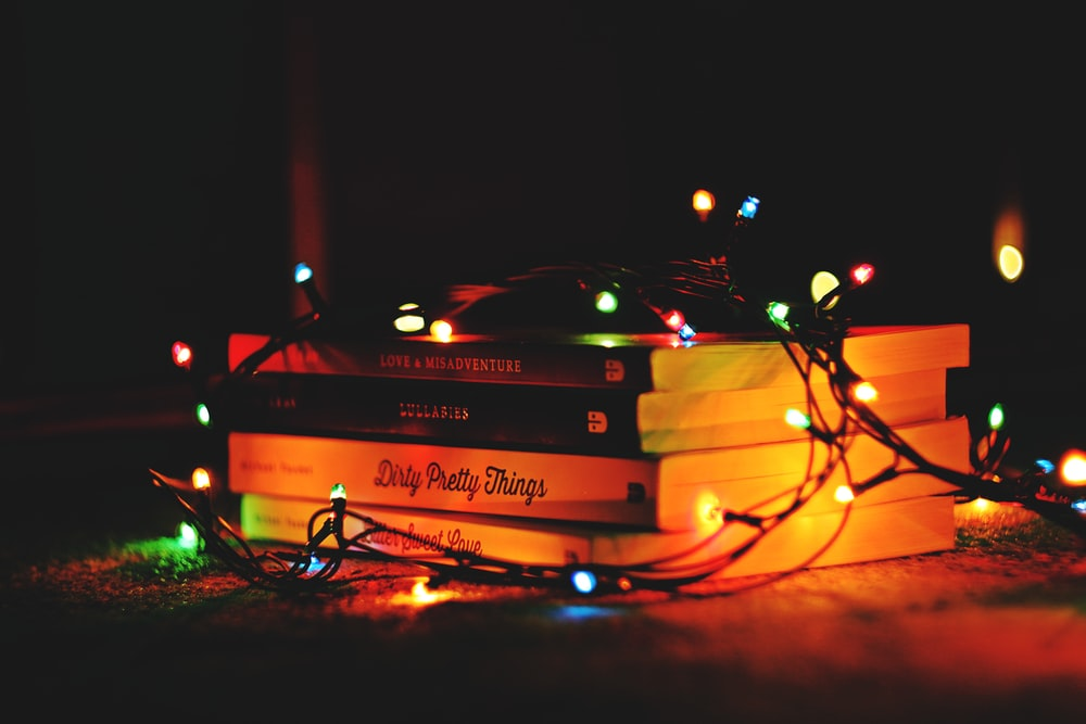pile of books with LED strip lights