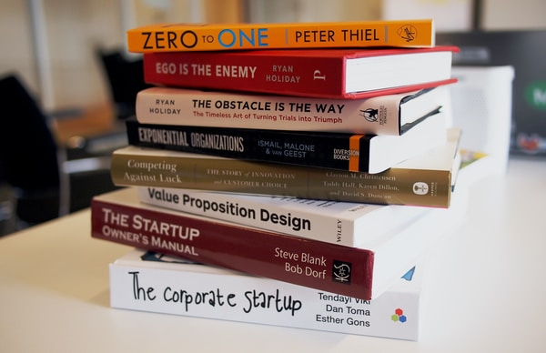 Start Your Own Games Business. pile of assorted-title books