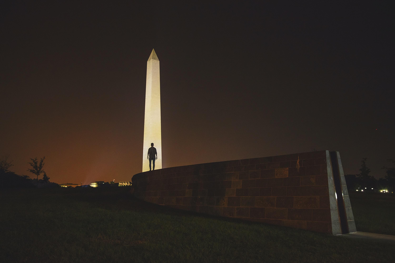 man standing on front of Obelisk in Egypt
