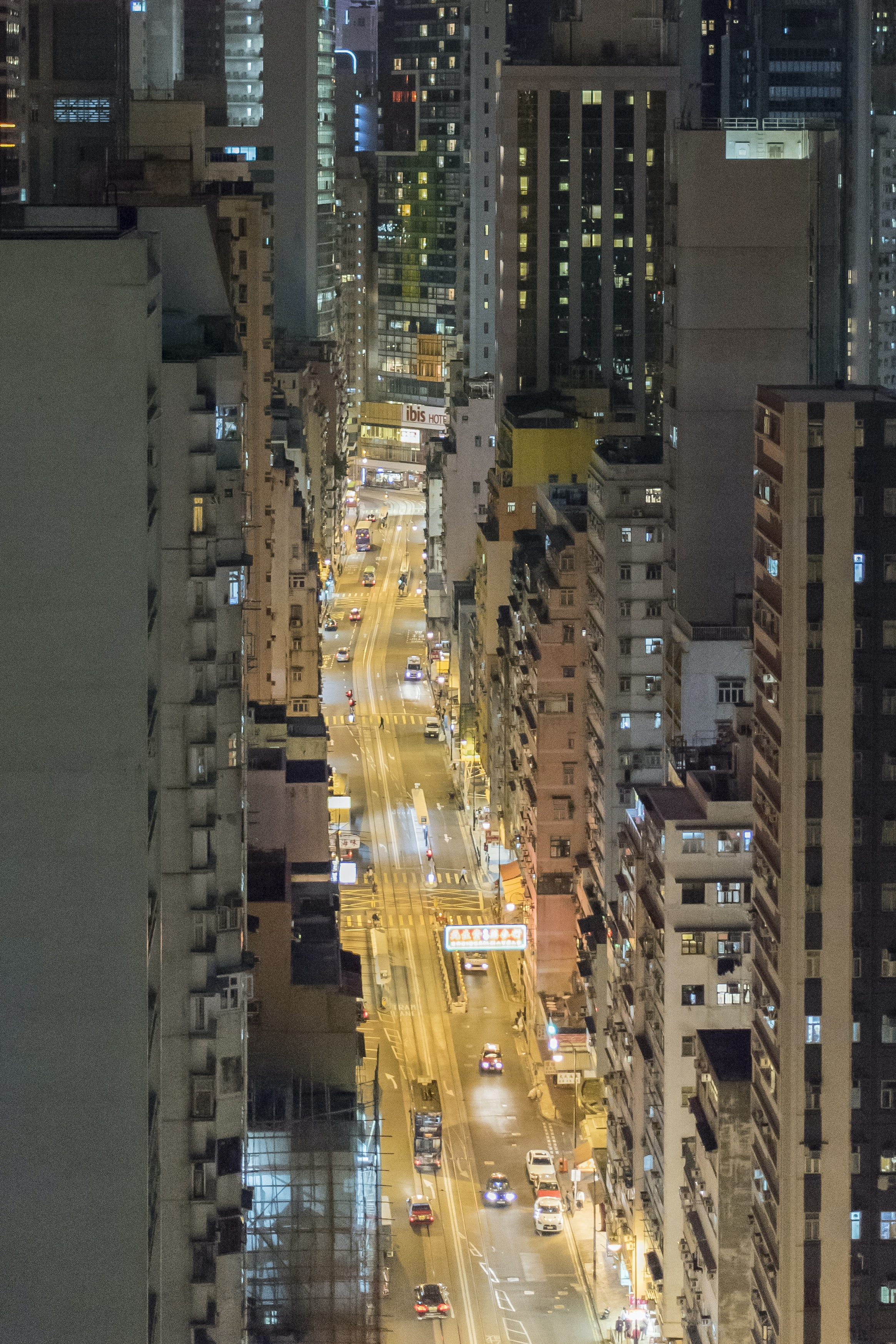 high angle photography of road with cars between buildings