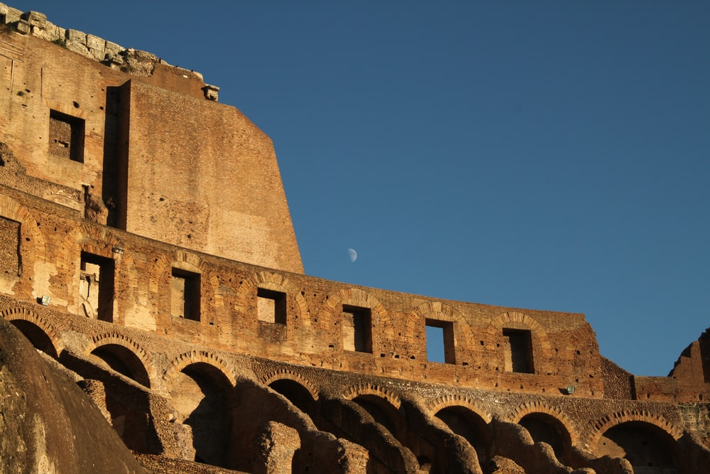 silhouette photo of The Colosseum wall