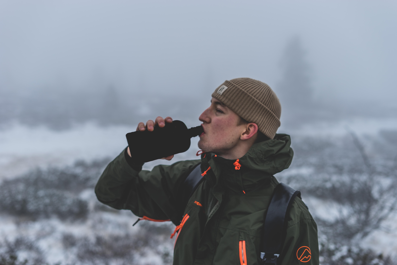 man drinking on flask