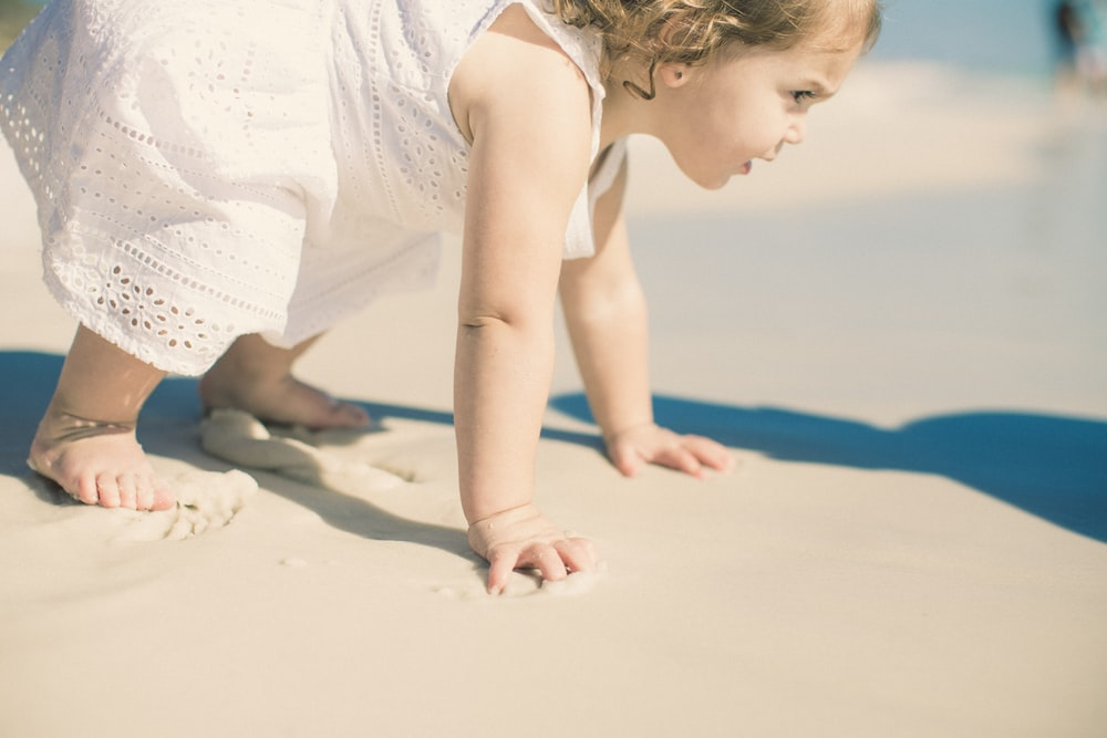 toddler's playing on sea shore