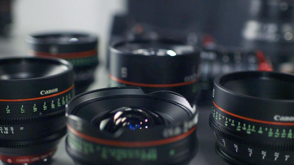 selective focus photography of Canon lenses