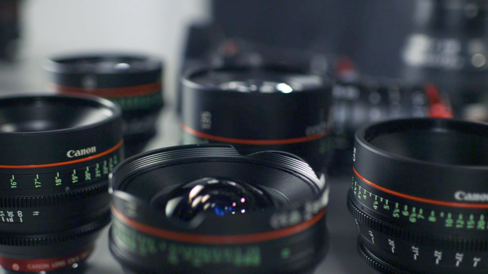 selective focus photography of Canon lenses