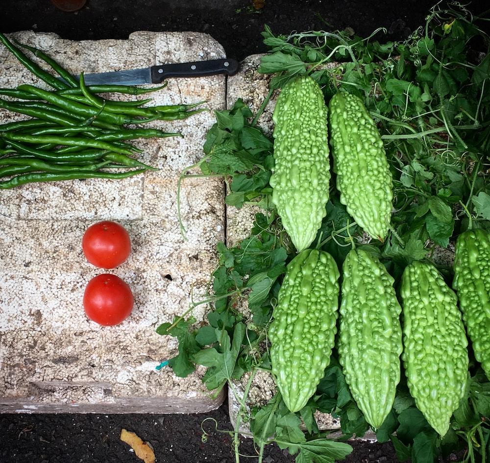 assorted vegetables on white styrofoam