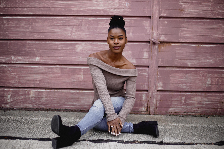 woman sitting on concrete floor