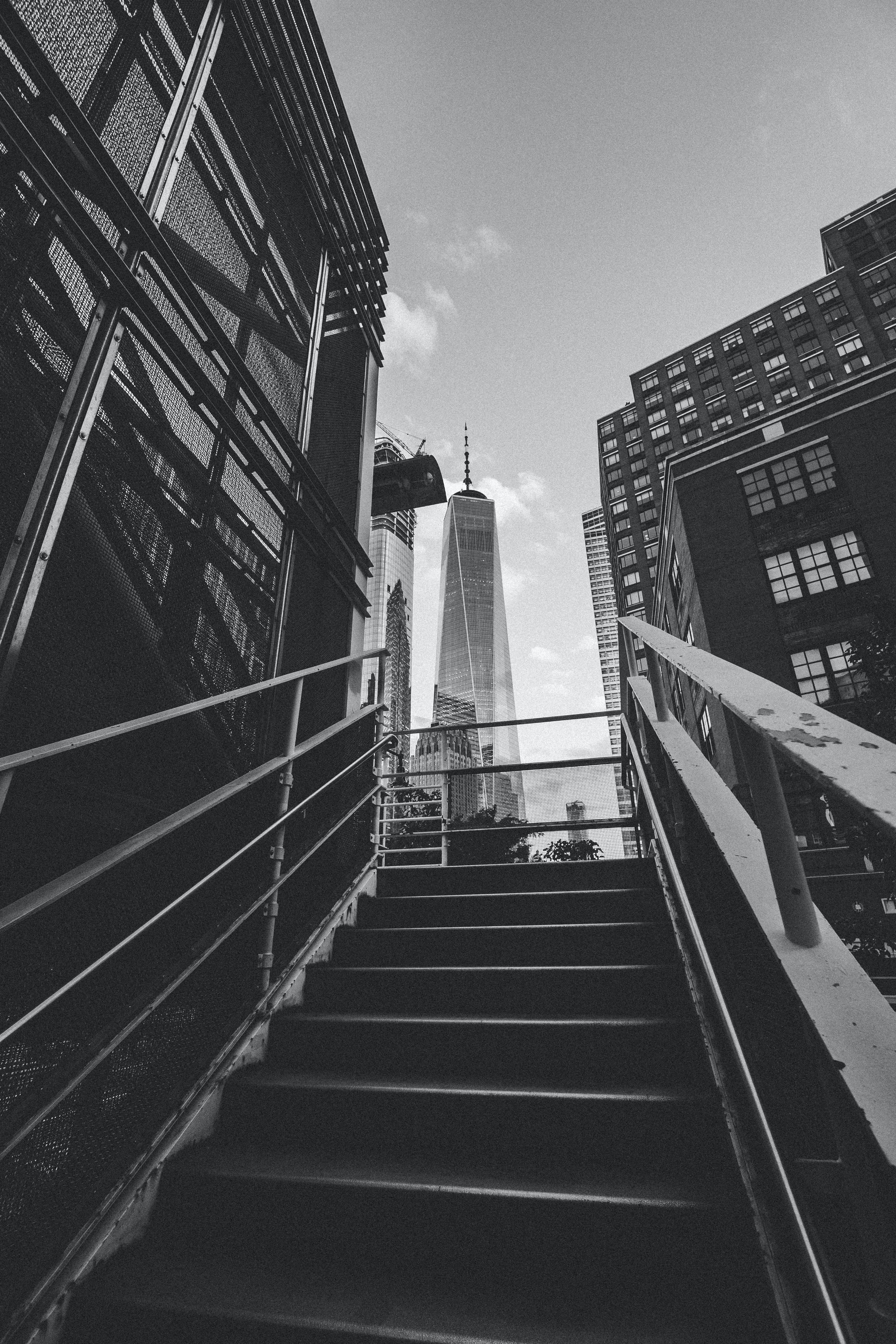 grayscale photography of stairway leading to building