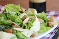 meat with lettuce on white ceramic plate