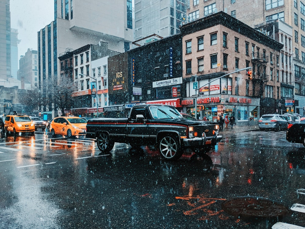 black single-cab pickup truck in street at daytime