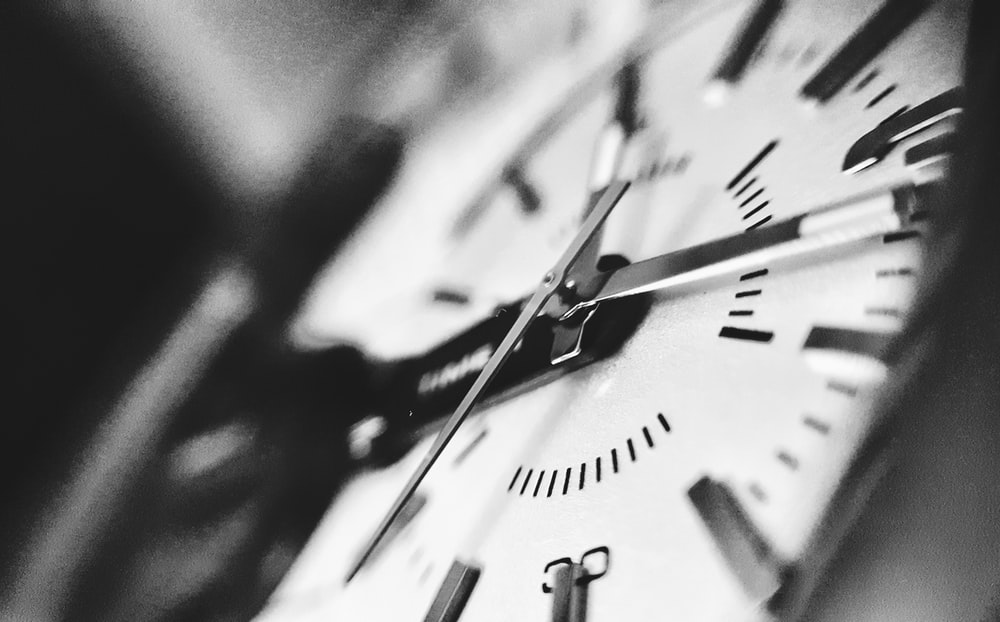grayscale photography of clock