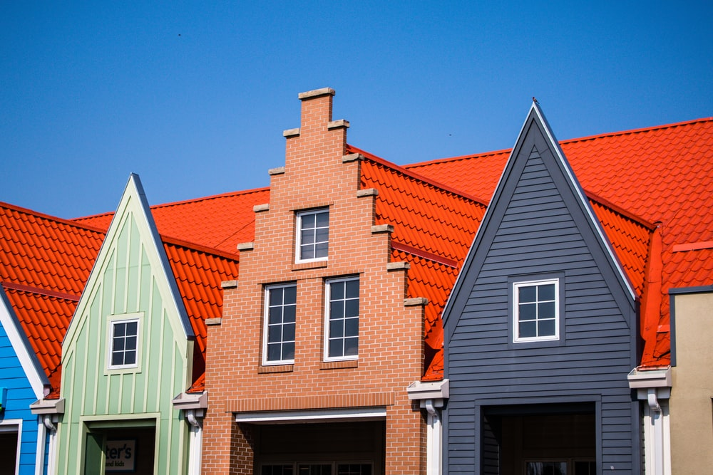 orange, gray, and teal painted house