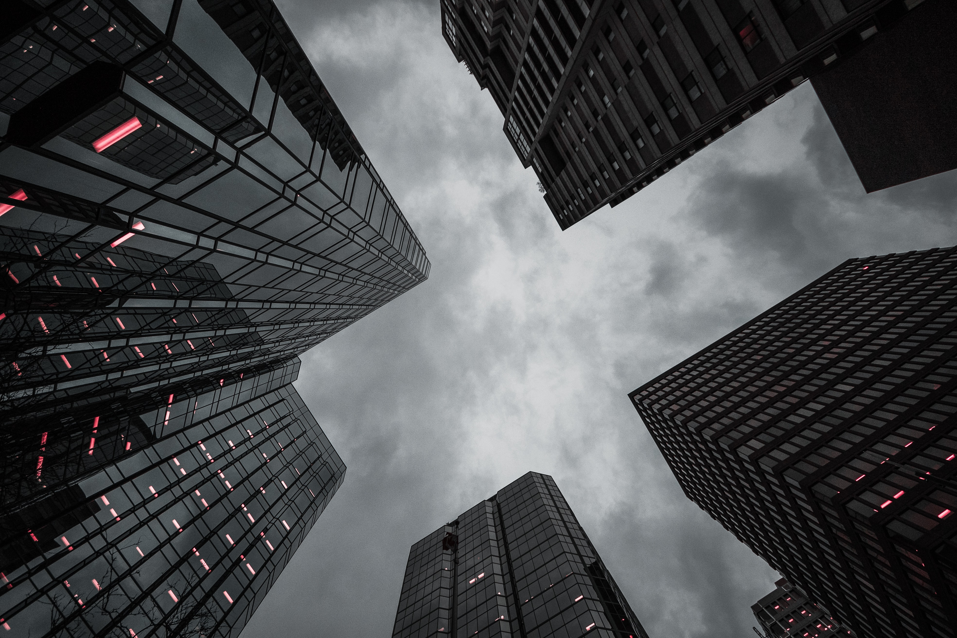worm's eye-view of high-rise building under the cloudy sky