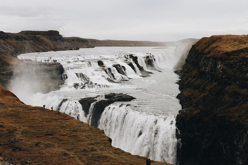 waterfalls under white skies