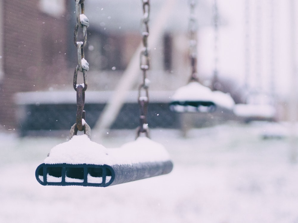 swing coated with snow