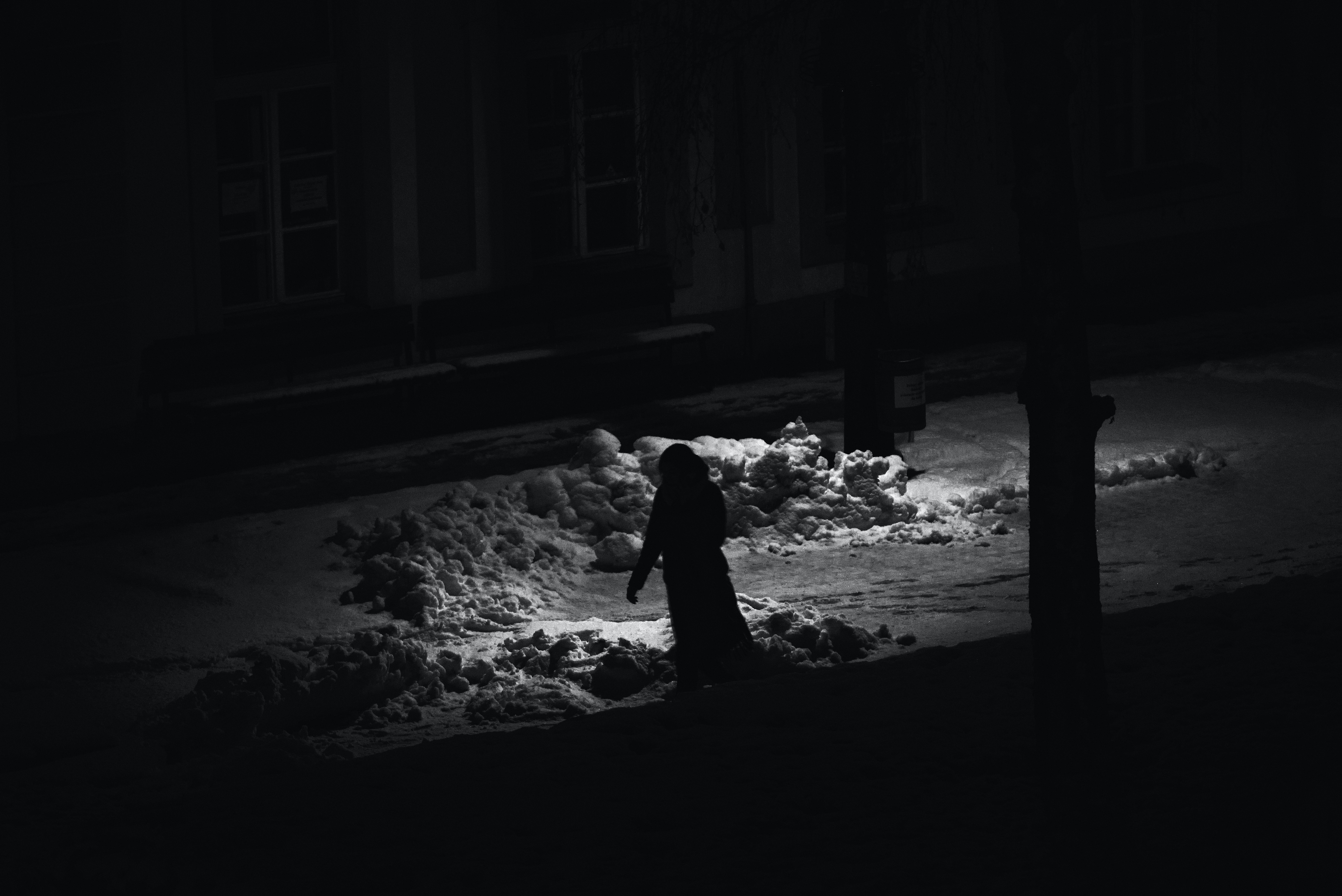 grayscale photography of person waling on street